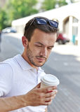 Young man with cup of coffee Stock Images
