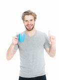 Young man with cup drinking coffee or tea, idea Stock Photography