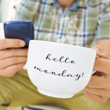 Young man with a cup with the text hello monday Stock Images