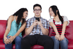 Young man with curious friends Royalty Free Stock Photos