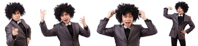 The young man with curly african wig isolated on white Stock Images