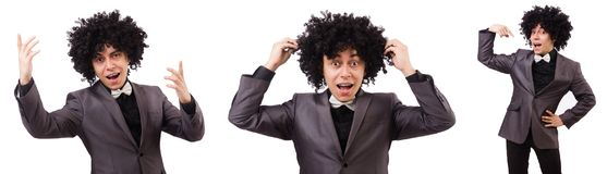 The young man with curly african wig isolated on white Stock Photo