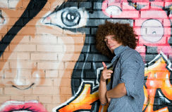 The young man with curly hair Stock Images