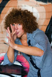 The young man with curly hair Stock Photography