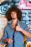 The young man with curly hair Royalty Free Stock Images