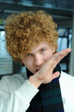 Young man with curly hair Royalty Free Stock Photo