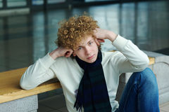Young man with curly hair Stock Images