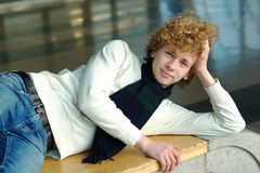 Young man with curly hair Royalty Free Stock Image