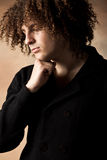 Young man with curly hair Stock Photo