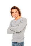 Young man with curly hair. Portrait of young man with curly hair and nice smile isolated on a white background Stock Photos