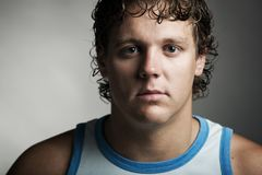Young man with curly hair Stock Image