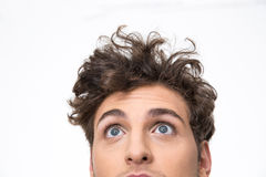 Young man with curly hair looking up at copyspace Royalty Free Stock Images
