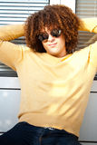 Young man with curly hair and sunglasses Stock Photos