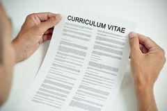 Young man with a curriculum vitae Stock Image