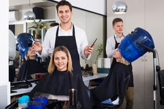 Young man cutting long hair of girl Royalty Free Stock Image