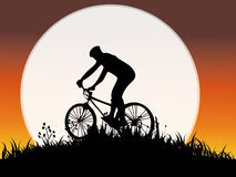 Young man cycling. With full moon Stock Photography