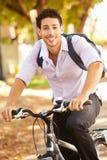Young Man Cycling Along Street To Work Stock Photos