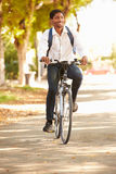 Young Man Cycling Along Street To Work Royalty Free Stock Photo