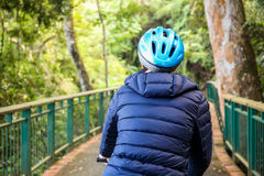 Young man cycling in the forest trail in cold weather during weekend Royalty Free Stock Image