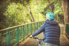 Young man cycling in the forest trail during weekend Royalty Free Stock Photos