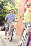 Young man cycling with his girlfriend Stock Photography