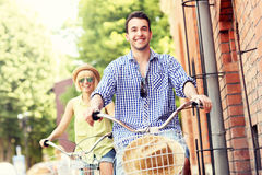 Young man cycling with his girlfriend Stock Images