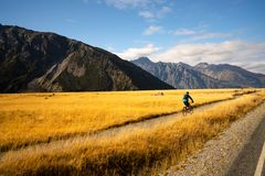 Free Young Man Cycling Mountain Bike Along The Rural Trail Royalty Free Stock Photography - 154905087