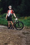 The young man cycling on mountain bike ride Cross-country Stock Images
