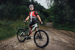 The young man cycling on mountain bike ride Cross-country Royalty Free Stock Photo