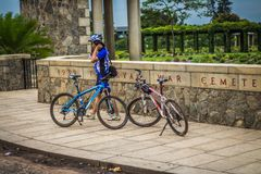 Young man cycling on a rural road and took pictures of nature along the way in the countryside on holiday. Yangon, Myanmar - June 06, 2016 : Young man cycling stock image