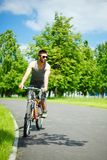 Young man cyclist Stock Images