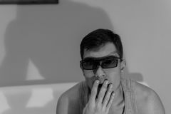 Young man in 3D glasses at home Stock Image
