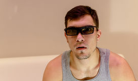 Young man in 3D glasses at home Royalty Free Stock Photo