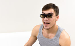 Young man in 3D glasses at home Stock Photography