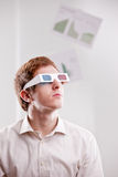 Young man with 3d glasses. Portrait of a young man in 3d glasses looking into the future Royalty Free Stock Images