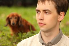 Young man with dachshund  outdoor Royalty Free Stock Images