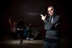 Young man and dancers Royalty Free Stock Photography