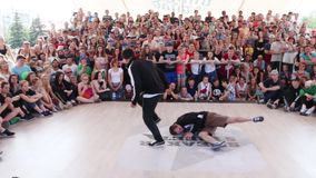 Young man dances breakdance at Street fight festival on street stage during Day of Russia holiday stock video