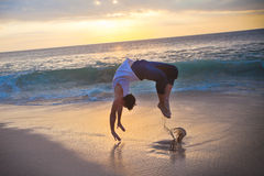 Young man dancing at the beach Stock Photo