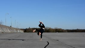 Young man dancing breakdance on the street stock footage