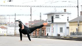 Young man dancing breakdance on the street. stock video footage