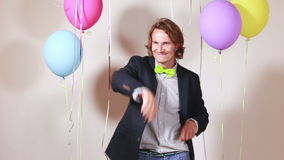 Young man dancing funny in photo booth stock footage