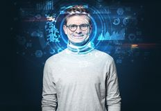 Young man on dark background, face recognition concept royalty free stock photography