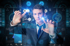 The young man in data management concept Stock Images