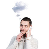 Young man daydream and speak on the phone. With white cloud owerhead  on white Stock Photography