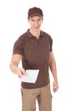 Young man delivering mail Royalty Free Stock Photos