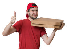 Young man is delivering pizza in boxes. Pizza delivery concept. Stock Images