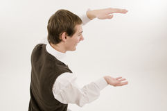 Young man demonstrating dimensions Royalty Free Stock Photos