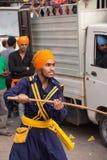 Young man demonstrating martial art skills during Guru Nanak Gur Stock Images
