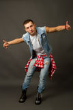 Young man in a denim vest Royalty Free Stock Photo